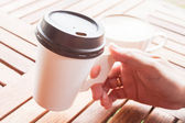 Hot coffee in paper cup serving at coffee shop — Stock Photo