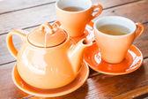 набор горячих чашек и чайник — Стоковое фото
