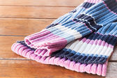 Close up knit wool scarf on wood table — Stock Photo
