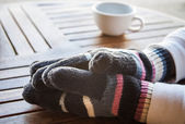 Coffee bar customer hands in winter — Stock Photo