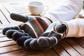 Warmly hands in wool gloves — Stock Photo