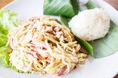 Mango spicy salad and sticky rice — Stock Photo