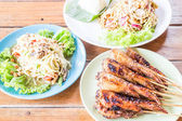Spicy meal with papaya and mango salad   — Stock Photo