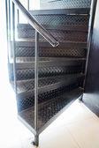 Dark metal modern spiral staircase — Stock Photo