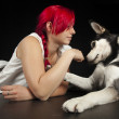 Red haired womwith cute husky dog — Stock Photo #24585503