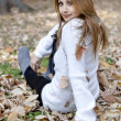 Stock Photo: Young girl in autumn forest. Outdoor.