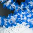 Computer keyboard with blue lei — Stock Photo