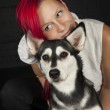 Red haired woman with cute husky dog - Stock Photo
