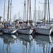 Yachts and boats in the harbor - Stock Photo