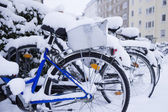 White snow covered bicycles — Stock Photo