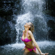 Beautiful woman at waterfall — Stock Photo