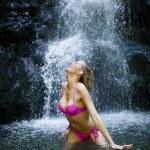 Beautiful woman at waterfall — Stock Photo