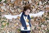 Smiling happy girl , lying in autumn leaves. Outdoor. — Foto Stock