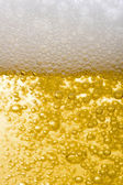 Beer close up bubbling — Stock Photo