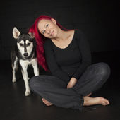 Red haired woman with cute husky dog — Stock Photo