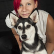 Red haired womwith cute husky dog — Stock Photo #24628049