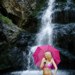 Beautiful woman at waterfall - Stock Photo