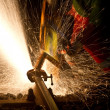 Stock Photo: Worker cutting metal