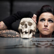 Woman with skull — Stock Photo
