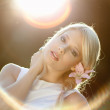 Beautiful young girl in sunlight — Stock Photo