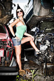 Funky girl at car junkyard — Stock Photo