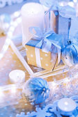 Christmas Box Gift on the Table in Blue Gold light — Stock Photo