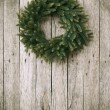 Royalty-Free Stock Photo: Green Christmas Wreath on Wooden Background