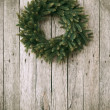 Green Christmas Wreath on Wooden Background — Stock Photo