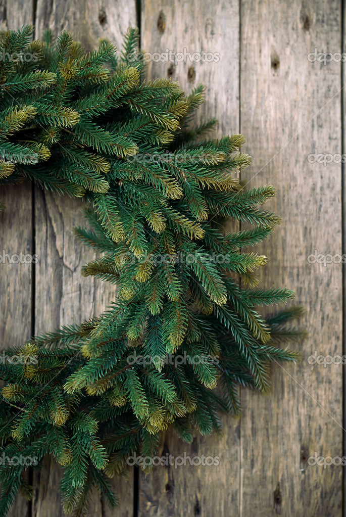 Green Christmas Wreath on Wooden Background — Stock Photo #15352329