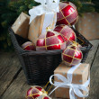 Christmas Card with Red Balls and Boxes in a Basket — Stock Photo