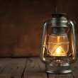 Oil Lamp at Night on a Wooden Surface — Stock Photo #15721801