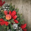 Christmas Card with Decorative Wreath on Wooden Background — Stock Photo #16830529