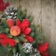 Christmas Card with Decorative Wreath on Wooden Background — Stock Photo