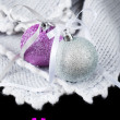 Christmas Card with Two Brilliant Balls on Knitted Blanket — Stock Photo #16830573