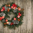 Christmas Wreath on Wooden Background — Stock Photo #16830663