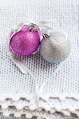 Christmas Card with Two Brilliant Balls on the Knitted Blanket — Stock Photo