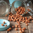 Nuts Scattered on the Wooden Table — Stock Photo