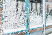 Wet Snow Stuck to the Window — Stock Photo
