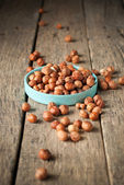 Nut Scattered on Wooden Table — Stock Photo