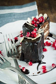 Chocolate Cake in the Shape of Heart Decorated with Pomegranate — Stock Photo