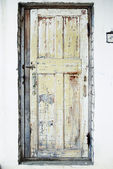 Old Door in the Wall with Cracked Paint Background — Stock Photo