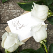 Photo: White Roses with Isolated Letter at Table