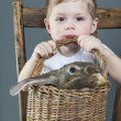 Portrait of the Cute Boy with Bunny in a Basket — Stock Photo