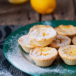 Lemon Tartlets on the green plate and lemons — Stock Photo