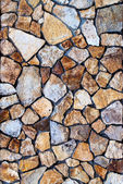 Masonry Wall of colors stones with irregular pattern, background — Stock Photo
