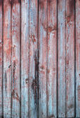 Old Wooden Planks in the Row of red and blue color, background — Stock Photo