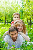 Happy Smiling Family in a park — Stock Photo