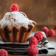 Fruitcake Decorated with Raspberry at the wooden table — Stock Photo
