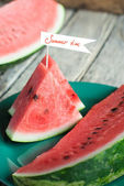 Pieces of Water-melon decorated with flag — Stock Photo