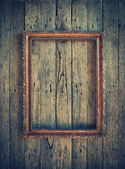 Old Vintage Frame on the wooden wall — Stock Photo